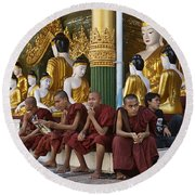 faithful Buddhist monks siiting around Buddha Statues in SHWEDAGON PAGODA Round Beach Towel