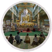 faithful Buddhists praying at sitting Buddha in golden Ponnya Shin Pagoda Round Beach Towel