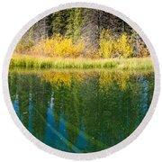 Fall Sky Mirrored On Calm Clear Taiga Wetland Pond Round Beach Towel