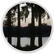 Family Silhouetted By Lake Round Beach Towel