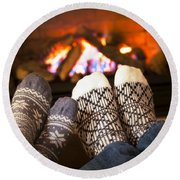 Feet Warming By Fireplace Round Beach Towel