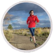 Female Runner In Colorado Round Beach Towel
