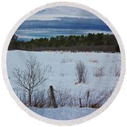 Fence And Snowy Field Round Beach Towel