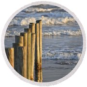 Fence Posts Into The Sea Round Beach Towel