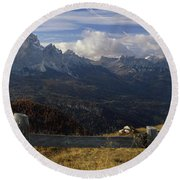Fence With A Mountain Range Round Beach Towel