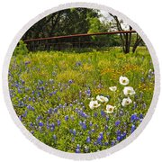 Fenceline Wildflowers Round Beach Towel