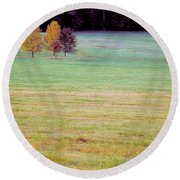 Field With Four Trees Round Beach Towel