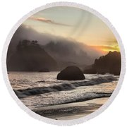 Fire Over The Sea Stacks Round Beach Towel by Adam Jewell