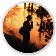 Firefighter At Night On The White Draw Fire Round Beach Towel