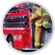 Fireman On Back Of Fire Truck Round Beach Towel