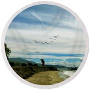 Flight Of Pelicans Round Beach Towel