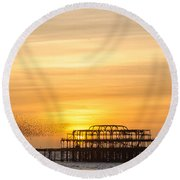 Flock Of Starlings Over The West Pier In Brighton Round Beach Towel