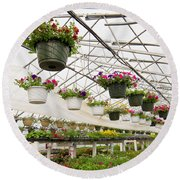 Flowers Growing In Foil Hothouse Of Garden Center Round Beach Towel