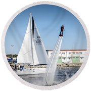 Flying In The Water Round Beach Towel