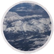 Flying Over The Snow Covered Rocky Mountains Round Beach Towel