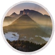 Fog Covered Mountains At Sunset Round Beach Towel