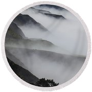 Foggy Coastal Hills Round Beach Towel