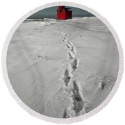 Footprints Leading From The Lighthouse Big Red During Winter Round Beach Towel