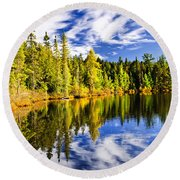 Forest And Sky Reflecting In Lake Round Beach Towel