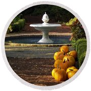 Fountain And Pumpkins At The Elizabethan Gardens Round Beach Towel