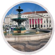 Fountain And Theater On Rossio Square In Lisbon Round Beach Towel