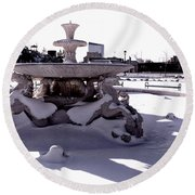 Fountain In The Snow Round Beach Towel