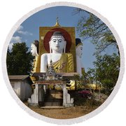 four sitting Buddhas 30 metres high looking in four points of the compass at Kyaikpun Pagoda Round Beach Towel