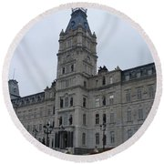 Full View Of Quebec's Parliament Building Round Beach Towel