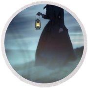 Ghostly Victorian Woman With A Lamp In Fog At Night Round Beach Towel