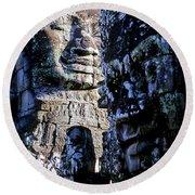 Gigantic Face Statues At Khmer Temple Angkor Wat Ruins Cambodi Round Beach Towel