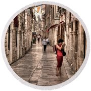 Girl In Red In The White Streets Of Dubrovnik Round Beach Towel