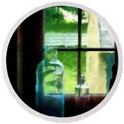 Glass Bottles On Windowsill Round Beach Towel