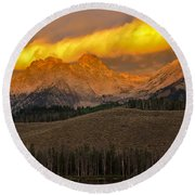 Glowing Sawtooth Mountains Round Beach Towel