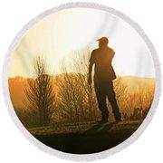 Golfer At Sunset Round Beach Towel
