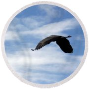 Great Blue Heron Flying Past The Clouds Above Trojan Pond 2 Round Beach Towel