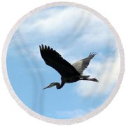 Great Blue Heron Flying Past The Clouds Above Trojan Pond Round Beach Towel