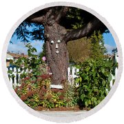 Guardian Of The Flowers Round Beach Towel