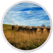 Hay Bales And Contrails Round Beach Towel