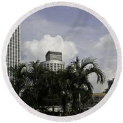 High Rise Buildings Behind Trees Along With Construction Work In Singapore Round Beach Towel