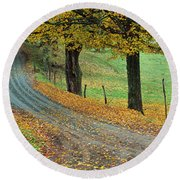 Highway Passing Through A Landscape Round Beach Towel