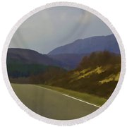 Highway Running Through The Wilderness Of Scottish Highlands Round Beach Towel