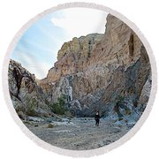 Hiker In Big Painted Canyons Trail In Mecca Hills-ca Round Beach Towel
