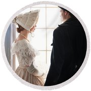 Historical Couple Standing By A Window Round Beach Towel