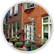 Homes Along The Canal In Enkhuizen-netherlands Round Beach Towel