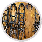 Horse Bridles Hanging In Stable Round Beach Towel