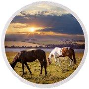Horses Grazing At Sunset Round Beach Towel
