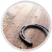 Horseshoe On Wood Floor Round Beach Towel
