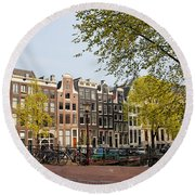 Houses On Singel Canal In Amsterdam Round Beach Towel