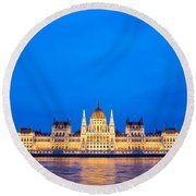 Hungarian Parliament Building At Dusk Round Beach Towel