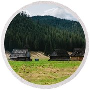 Huts In The Hills Round Beach Towel